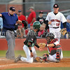 Colleyville senior catcher Joel Quitanilla tags Carroll's Ronnie Mitchell out at the plate.