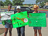 Kierra, Patricia and Diamond Mitchell hold up signs supporting Carroll outfielder Ronnie Mitchell prior to the State Final game at Dell Diamond field, Round Rock, June 7. 2008.
