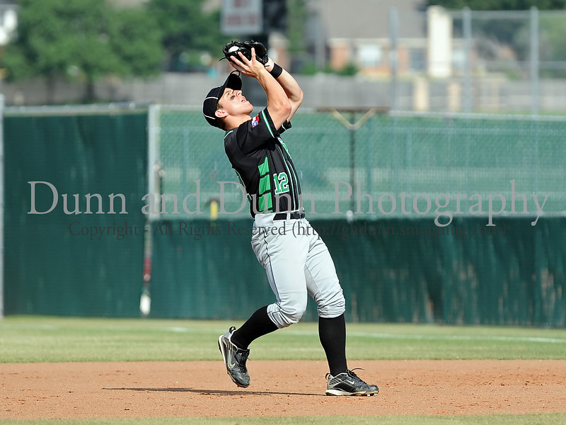 Carroll junior infielder Tommy Avers catches a popup for an out in the Bi District Championship series against Colleyville Heritage last Friday afternoon.  Carroll defeated Heritage 3-2 to sweep the best 2 of 3 series and to end Heritage's 2009 season.