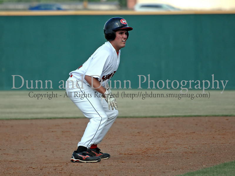 Colleyville Heritage junior outfielder Tate Roush looks to steal third in the Bi District Championship series against Southlake Carroll last Friday afternoon.  Carroll defeated Heritage 3-2 to end Heritage's 2009 season.
