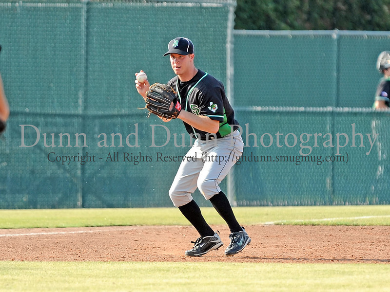 Carroll senior infielder Josh Rake fields a grounder and prepares to throw to first in the Bi District Championship series against Colleyville Heritage last Friday afternoon.  Carroll defeated Heritage 3-2 to sweep the best 2 of 3 series and to end Heritage's 2009 season.