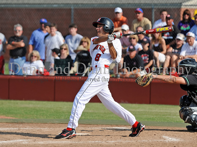 Colleyville Heritage senior Scott McDonald bats in the Bi District Championship series against Southlake Carroll last Friday afternoon.  Carroll defeated Heritage 3-2 to end Heritage's 2009 season.