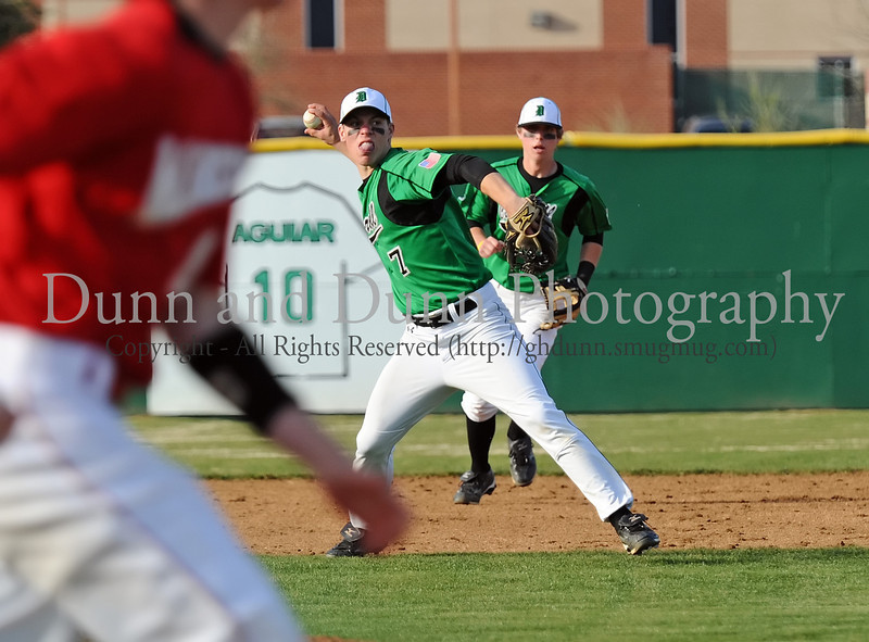 Carroll senior Brandon Thompson throws a Marcus runner out for the last out in Carroll's 7-0 victory over Flower Mound Marcus, last Friday afternoon at Carroll Senior High School.