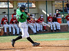 Carroll infielder Patrick McLendon hits a two run home run to put Carroll up 2-0 in Carroll's 7-0 win over Flower Mound Marcus, last Friday afternoon at Carroll Senior High School.