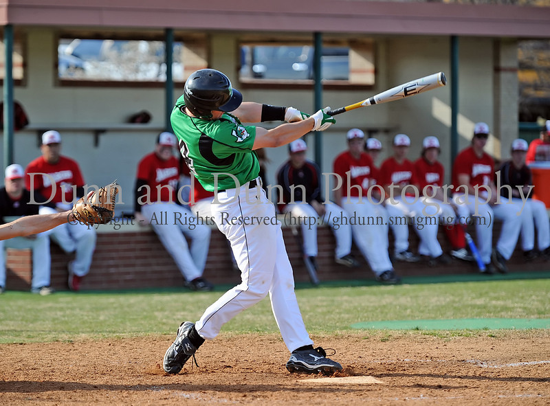 Carroll outfielder Jake Havens hits a 2-run homerun in the bottom of the 5th inning to cap Carroll's 7-0 victory over Flower Mound Marcus last Friday afternoon at Carroll Senior High School. In the game, Havens went 2 for 3 with the 2-run homerun and a RBI single.