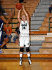 Carroll junior post ML Morrison attempts a three point shot in the game Friday night against Hebron.