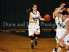 Carroll senior guard Kelli Bennett brings the ball up in the game Friday night against Hebron.