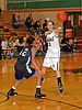 Carroll sophomore guard Monica Pillow passes to a teammate in the game Friday night against Hebron.