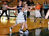 Carroll junior post Christie Groh passes to a teammate in the game Friday night against Hebron.