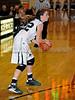 Carroll senior guard Kelli Bennett looks for an open teammate in the game Friday night against Hebron.