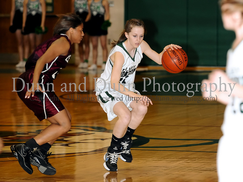 Carroll freshman guard Caitlin Barrett starts the offiense in the game against Lewisville last Friday night at Carroll Senior High School.