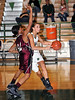 Carroll junior post Deborah Chandler drives to the basket in the game against Lewisville last Friday night at Carroll Senior High School.