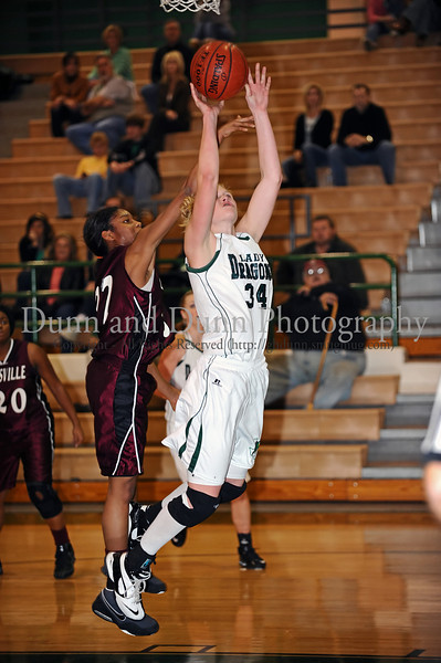 Carroll junior post ML Morrison goes for a rebound in the game against Lewisville last Friday night at Carroll Senior High School.