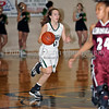 Carroll freshman guard Caitlin Barrett brings up the ball in the game against Lewisville last Friday night at Carroll Senior High School.