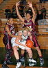 Carroll junior post Christie Groh pulls down a rebound in the game against Lewisville last Friday night at Carroll Senior High School.