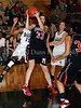 Marcus sophomore Hailie Sample grabs a rebound in the game against Carroll last Friday night at Carroll Senior High School.