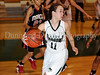 Carroll freshman guard Caitlin Barrett grabs a rebound in the game against Marcus last Friday night at Carroll Senior High School.