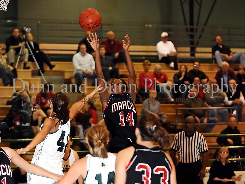 Marcus senior Adriene Easley takes a jump shot in the game against Carroll last Friday night at Carroll Senior High School.