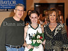 Carroll senior guard Kelli Bennett with her parents Dave and Chris Bennett at Senor Night ceremonies at halftime during the game against Marcus last Friday night at Carroll Senior High School.