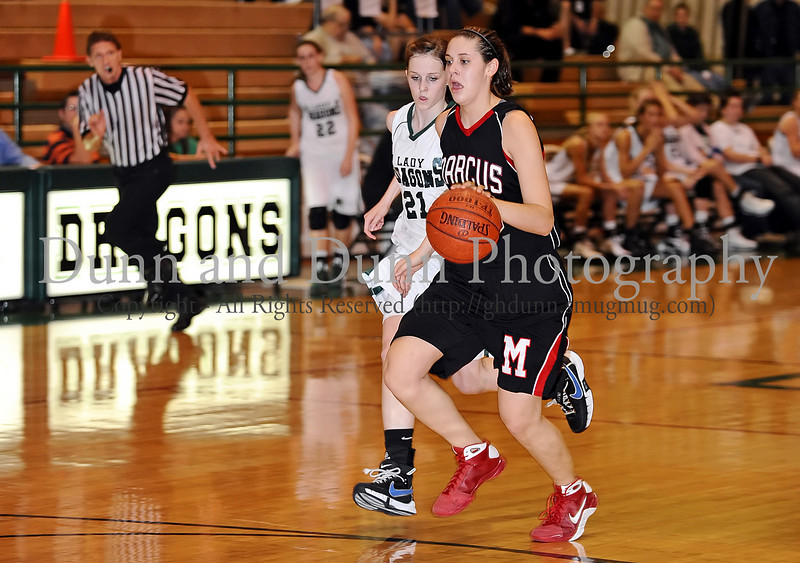 Marcus sophomore Hailie Sample brings up the ball in the game against Carroll last Friday night at Carroll Senior High School.