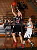 Marcus sophomore Hailie Sample takes a shot in the game against Carroll last Friday night at Carroll Senior High School.