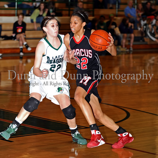 Marcus junior Jasmine Shaw drives to the basket in the game against Carroll last Friday night at Carroll Senior High School.