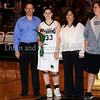 Carroll senior forward Casey Lewis with her parents Casey and Carla Lewis at Senor Night ceremonies at halftime during the game against Marcus last Friday night at Carroll Senior High School.
