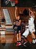 Marcus junior Jasmine Shaw takes a shot in the game against Carroll last Friday night at Carroll Senior High School.