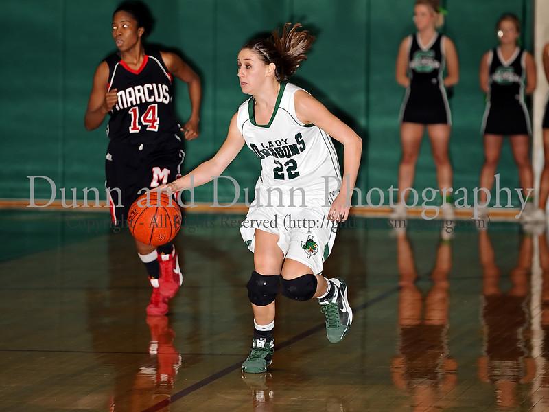 Carroll senior guard Kelli Bennett brings up the ball in the game against Marcus last Friday night at Carroll Senior High School.