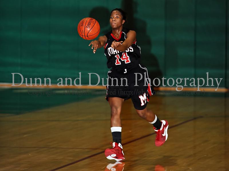 Marcus senior Adriene Easley passes the ball in the game against Carroll last Friday night at Carroll Senior High School.