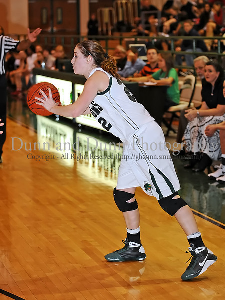 Carroll senior guard Kelli Bennett passes the ball to a teammate in the game against Marcus last Friday night at Carroll Senior High School.