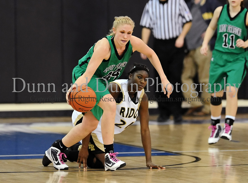44 - Carroll senior Christi Groh secures a loose ball in Carroll's win over Fossil Ridge in Monday's Bi-District Playoff game at Byron Nelson High School.
