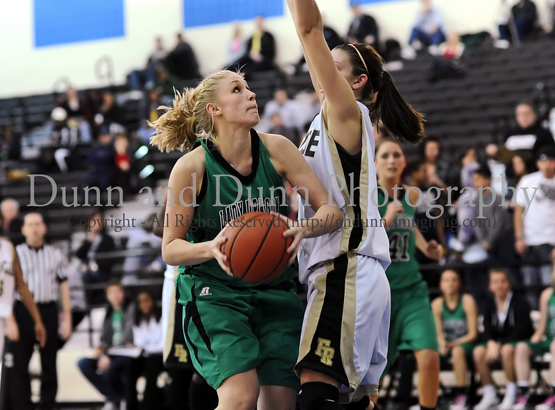 44 - Carroll senior Christi Groh takes the ball to the hoop in Carroll's win over Fossil Ridge in Monday's Bi-District Playoff game at Byron Nelson High School.