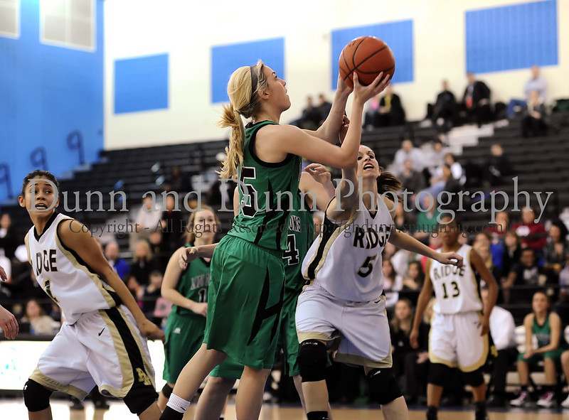 15 - Carroll guard Sierra Mickus takes a shot in Carroll's win over Fossil Ridge in Monday's Bi-District Playoff game at Byron Nelson High School.
