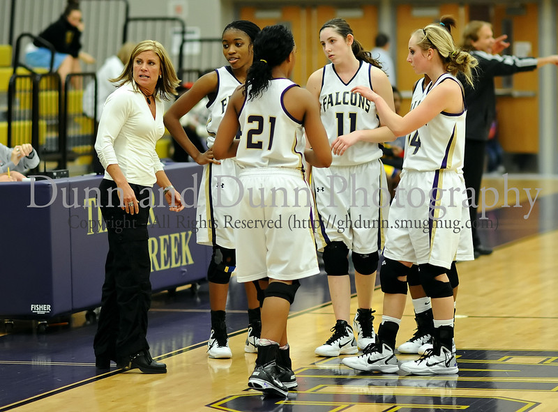 Timber Creek head coach Tina Matthews provides advice during a timeout in the Falcon's 36-35 victory over Everman last Friday night at Timber Creek High School.