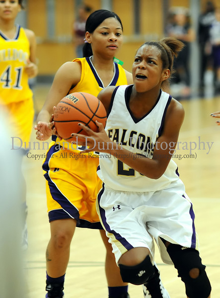 Timber Creek guard Mia Melton drives to the basket in the Falcon's 36-35 victory over Everman last Friday night at Timber Creek High School.