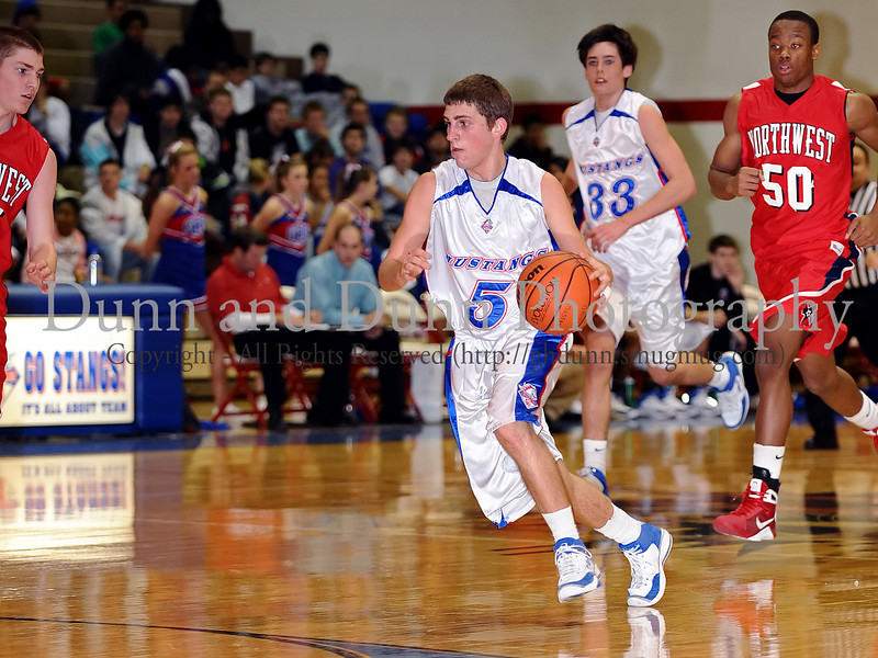 Grapevine senior guard Kody Diehm brings up the ball in the game against Northwest last Thursday night at Grapevine High School.