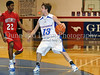 Grapevine junior guard Robert Risk looks for an open player in the game against Northwest last Thursday night at Grapevine High School.
