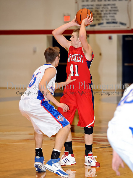 Northwest senior Ryan Russell looks for an open player in the game against Grapevine last Thursday night at Grapevine High School.