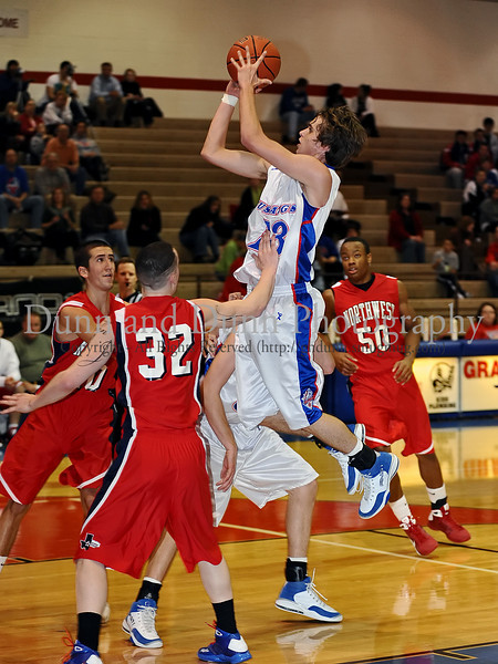 Grapevine junior guard Robert Risk takes a shot in the game against Northwest last Thursday night at Grapevine High School.