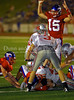 Senior Ethan Davis signals a touchdown as Grapevine's  Matt Harbin rushes for Grapevine's second touchdown in the game against Marcus on September 7, 2007.