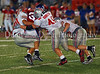 Senior running back Kale Gelles is swarmed by Marcus defenders sefety Brode Boyd and linebacker Landon Banister in the game between Grapevine and Marcus on September 7, 2007.