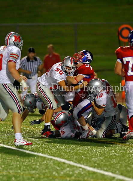 Senior running back Kale Gelles is gang-tackled by Marcus defenders Kevin Deaver, Taylor Hardin  and Kenneth Eneh in the game between Grapevine and Marcus on September 7, 2007.