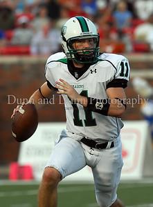 Carroll quarterback Riley Dodge sprints for yardage in the game Saturday night against Miami Northwestern.