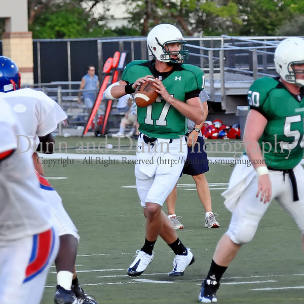 Quarterback Kyle Padron prepares to pass in the scrimmage against Grapevine High School Friday night at Dragon Stadium.