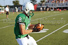 Wide receiver Ryan Blair warms up prior to the scrimmage against Grapevine High School Friday night at Dragon Stadium.