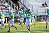 Quarterback Kyle Padron and other members of the Carroll team warm up prior to the scrimmage against Grapevine High School Friday night at Dragon Stadium.
