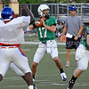 10 - Carroll quarterback Kyle Padron prepares to pass in the scrimmage against Grapevine High School Friday night at Dragon Stadium.