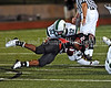 Carroll linebacker Cade Foster tackles Coppell running back Evans Okotcha in the game against Coppell last Friday night.  Carroll lost to Coppell in overtime 57-53.