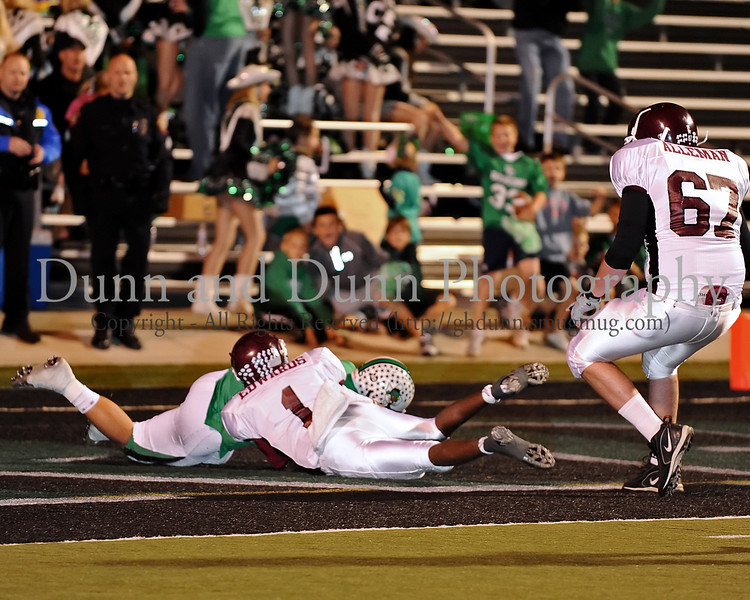 -Carroll defensive end Brayden Burnett recovers a Lewisville fumble in the end zone for a Carroll touchdown on the first play in the game Lewisville last Friday night at Dragon Stadium.